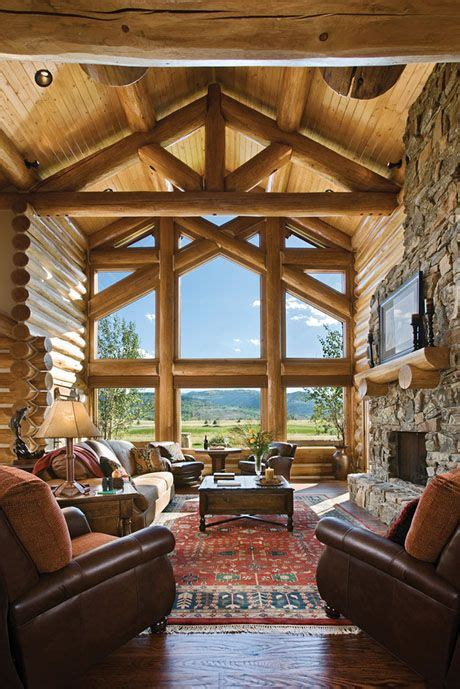 great room handcrafted trusses   window wall log
