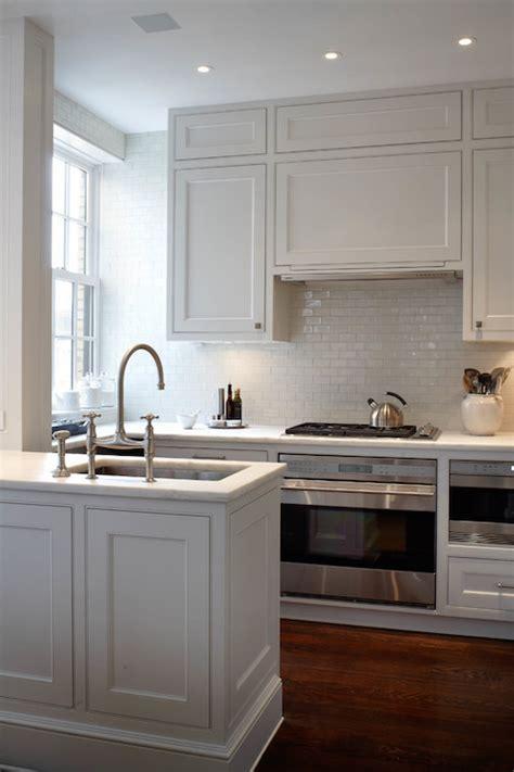 white glazed mini subway tiles transitional kitchen
