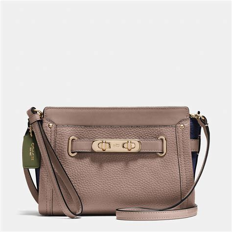 Coach Swagger Mini Colour Varian coach swagger wristlet in colorblock pebble leather in