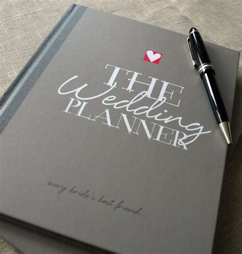 wedding planner by illustries and notebook with prompts to with planning