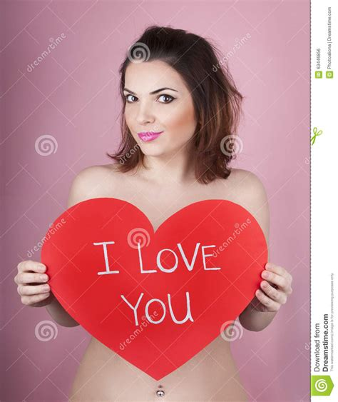woman with the biggest thing in her vigina woman holds big red heart i love you in her hands royalty
