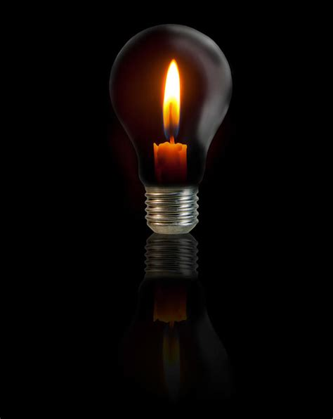 Candle Light Bulbs by Candle On Light Bulb On Black Background Photograph By