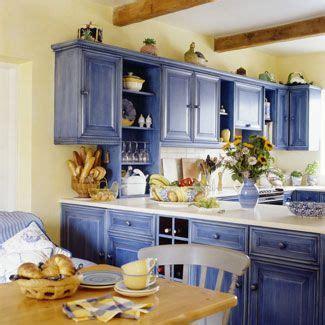 25 best ideas about blue yellow kitchens on yellow kitchen cabinets light yellow