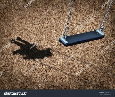 shadow swing missing child concept empty playground swing stock photo
