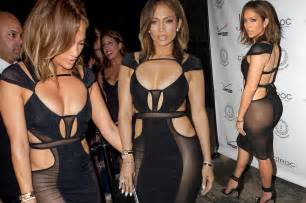 Lopez bares all in an outrageously racy dress as she celebrates her