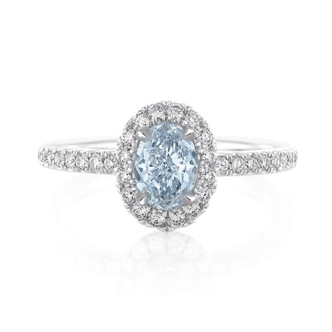 de beers aura platinum engagement ring with an oval cut