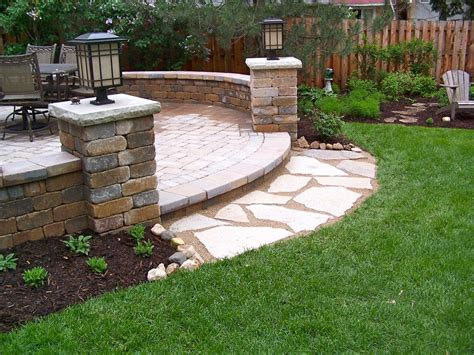 Unilock Pillars backyard unilock patio seat walls pillars flagstone landing lombard il land design