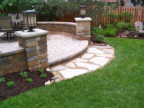 Backyard unilock patio, seat walls, pillars, flagstone