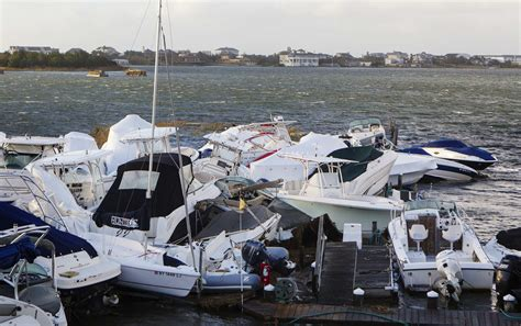hurricane sandy boats superstorm sandy leaves destruction darkness and death in