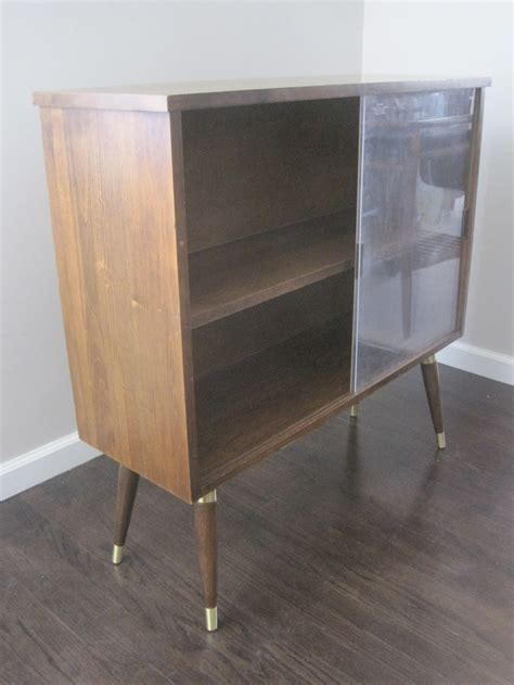 bookcase with sliding glass front brass tipped pencil