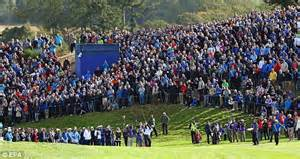 The large gallery watches phil mickelson play from the 18th fairway