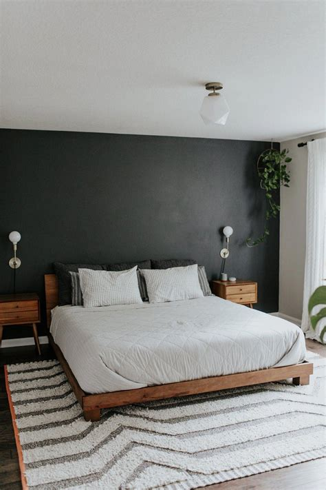 black accent wall wood mid century modern nightstands