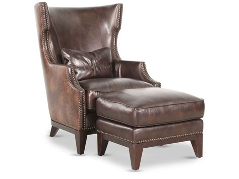 nailhead accented leather  chair  ottoman  brown mathis brothers furniture