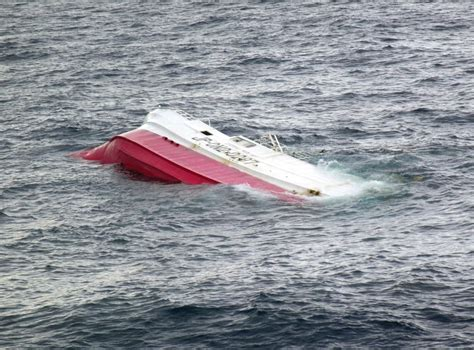 fishing boat capsized at sea search underway for crew of capsized fishing ship off