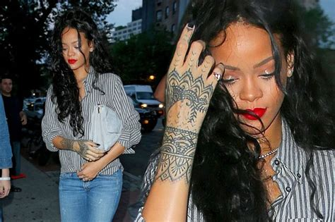 tattoo on rihanna s arm has rihanna tattooed entire lower arm star spotted with