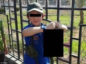 Australian jihadist khaled sharrouf s son 7 poses with decapitated