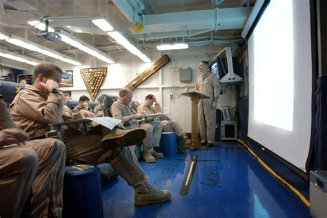 the ready room file us navy 030320 n 9964s 007 a u s marine aviator briefs pilots of carrier air wing three