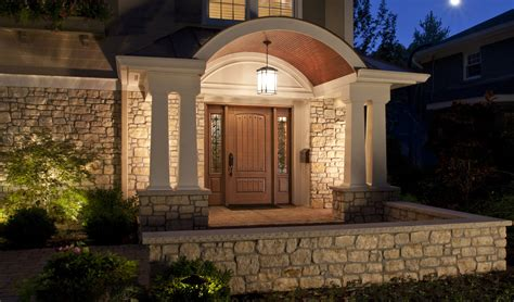 stone wall house design rustic modern house design with stone wall exterior and wall mounted lighting combined