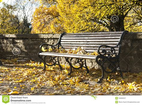 park bench pictures park bench in autumn royalty free stock photography image 34669047