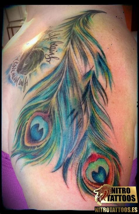 tattoo pluma peacock feather around the thigh plumas pavo real