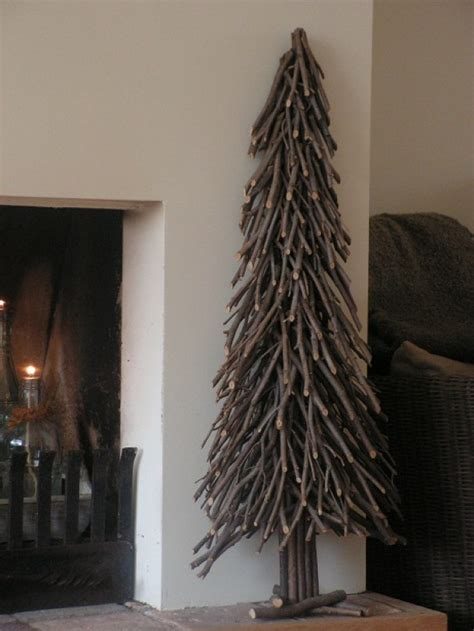 christmas tree made with twigs time to gather twigs and branches to make a tree this is cool crafts