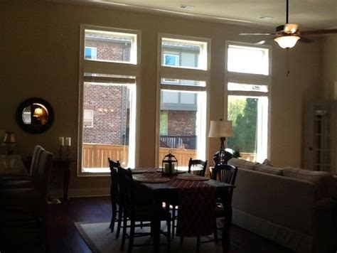 Tudor Style Windows need help with window treatments above or below transoms