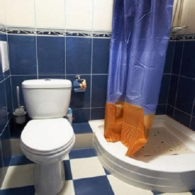 bathroom is clogged how to fix a clogged toilet with blue white tile http
