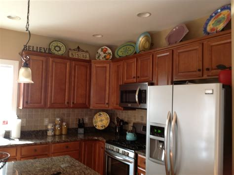 decorate top of kitchen cabinets wow top kitchen cabinet decorating ideas 82 upon