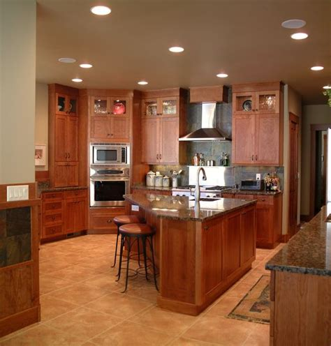 Triangle Kitchen Island Warm Inviting Kitchen With High Display Cabinets Triangle Shaped Island Shown In Cherry Wood