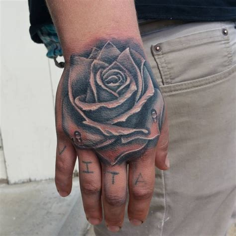 tattoo rose on hand black rose hand tattoo pinterest rose hand