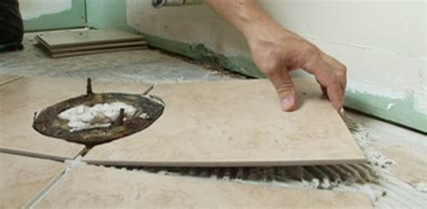 how to tile a bathroom floor around a toilet how to tile a bathroom floor today s homeowner