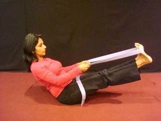 boat pose with strap yoga for a flat toned stomach