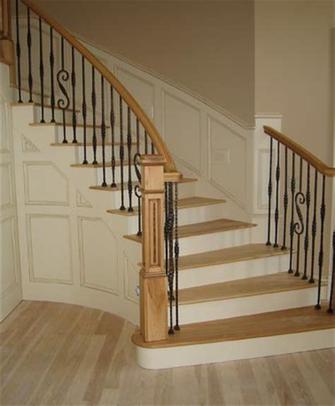 Curved Stair Railings by Curved Oak Staircase With Wrought Iron Railings