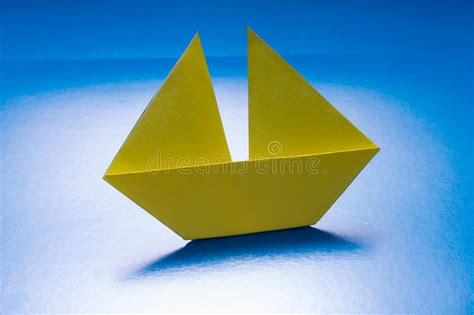 Origami Cruise Ship - paper boat sailing on blue paper sea origami ship stock