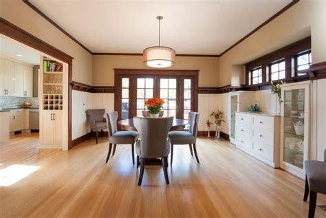 transitional dining room features oak flooring white