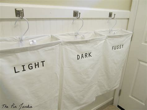 hanging laundry bag remodelaholic laundry room makeover with personalized
