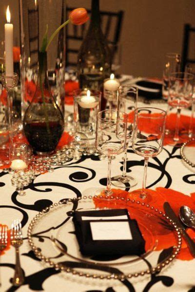 black orange silver white centerpieces place settings summer wedding reception photos