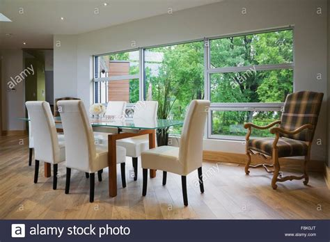 Front Room Chairs by Glass Dining Table And Leather Chairs In Front Of Large