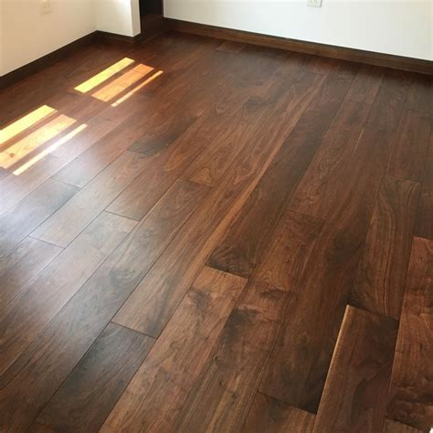 Walnut wide plank wood flooring finished with WOCA Master