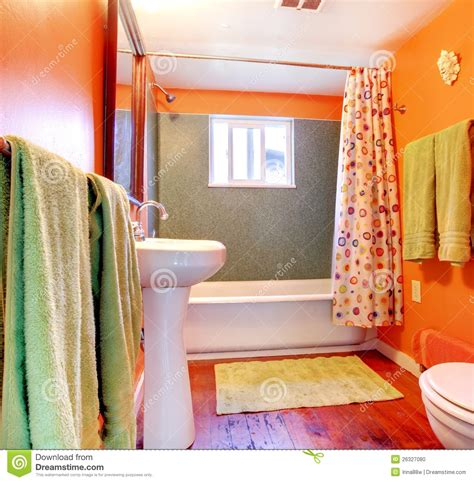 orange and green bathroom orange and green bathroom with tub and wood floor stock