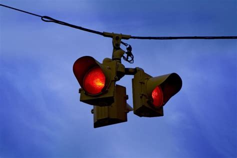 a flashing red light at an intersection means flashing beacons rural intersections synthesis of