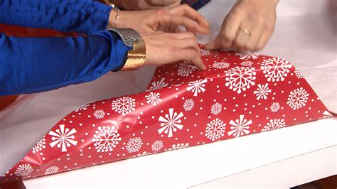 wrapping a gift wrap a present in under 15 seconds with this holiday hack