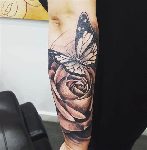 tattoos of roses and butterflies black grey ink large butterfly on arm