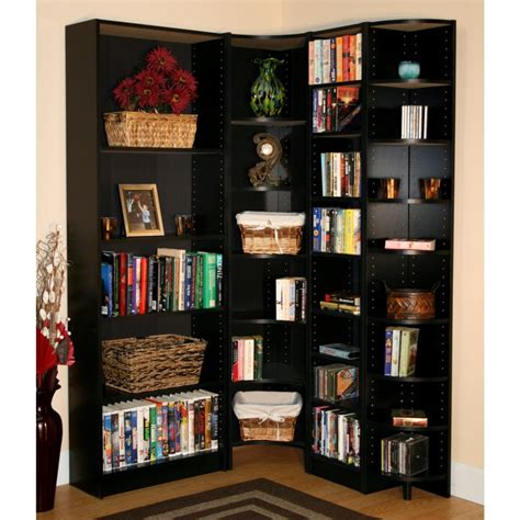 corner high black wooden bookcase with many shelves placed