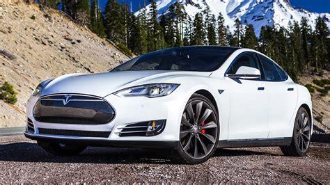 tesla motors electric cars clock   billion miles