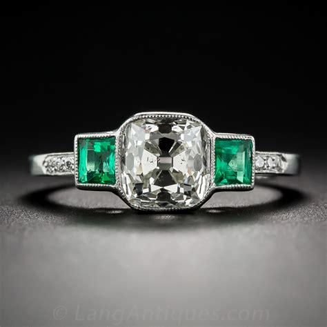 1 73 carat antique cushion and emerald ring