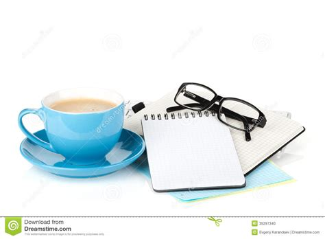 blue and white desk accessories blue coffee cup glasses and office supplies on white