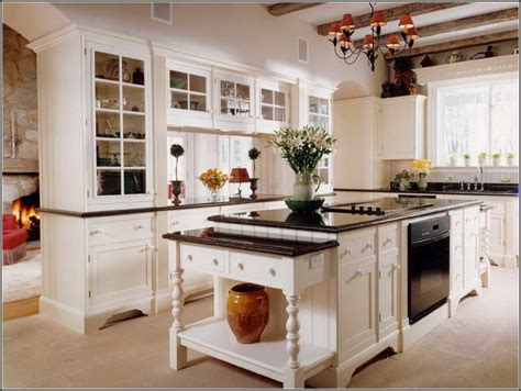 white kitchen cabinets with antique black granite