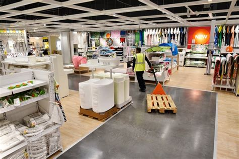 customers inside warehouse part of ikea home store stock why does ikea have people lining up before its grand