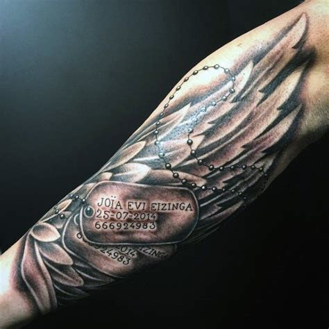 forearm dog tags tattoos for men with angel wings p 246 ff